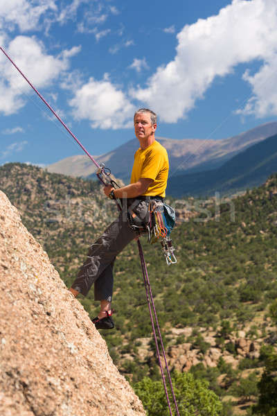 Senior man rappelling in Colorado Stock photo © backyardproductions