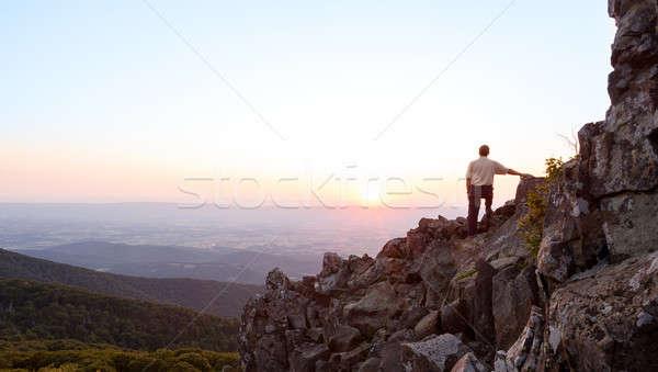 Senior man watches sunrise over blue ridge Stock photo © backyardproductions