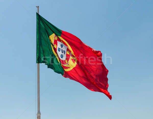 Portuguese Portugal Flag blows in wind Stock photo © backyardproductions