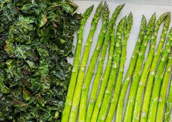 Kale and asparagus being roasted in oven Stock photo © backyardproductions