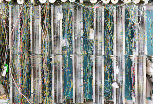 Telephone wiring panel on wall for telecoms Stock photo © backyardproductions