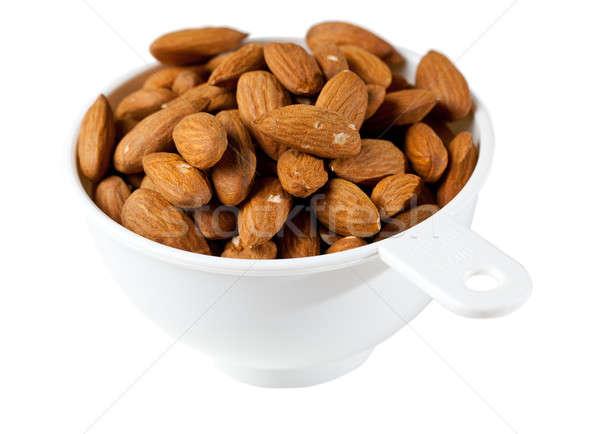 Raw organic almonds in measuring cup Stock photo © backyardproductions