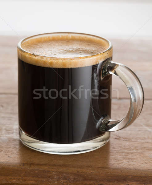 Black coffee and froth in glass mug wood table Stock photo © backyardproductions