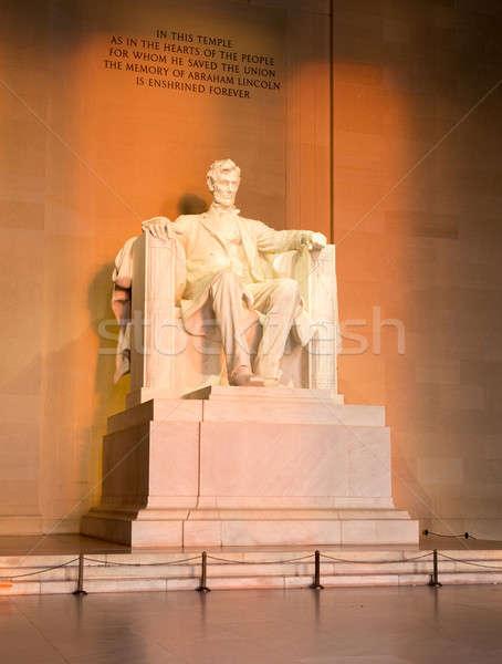 Sun at dawn illuminates Lincoln statue Stock photo © backyardproductions