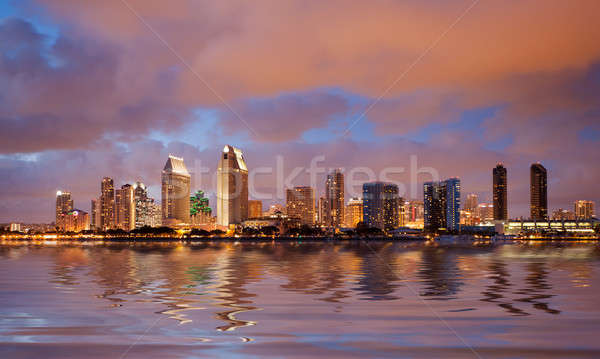 San Diego skyline at dusk reflected in sea Stock photo © backyardproductions