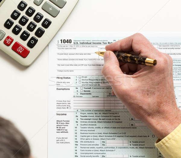 Pen calculator 2014 vorm 1040 mannelijke Stockfoto © backyardproductions