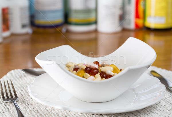 Vitamins in bowl of tablets  Stock photo © backyardproductions