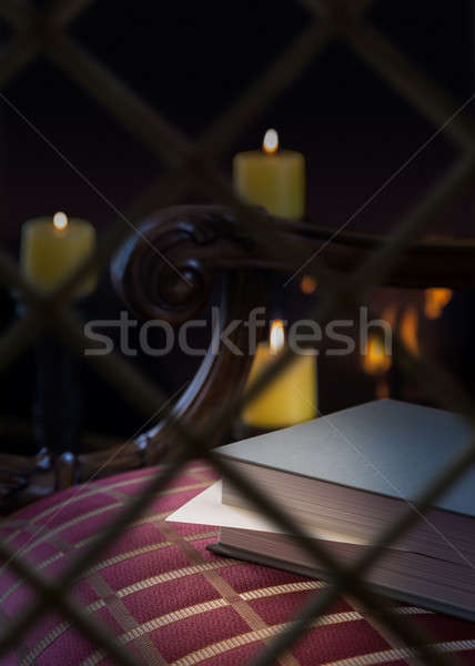 Envelope in book left on seat by fire Stock photo © backyardproductions