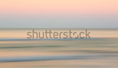 Sunrise over ocean with sideways pan Stock photo © backyardproductions