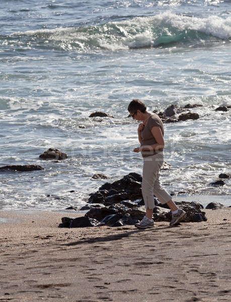 Woman beachcomb on Glass Beach Stock photo © backyardproductions