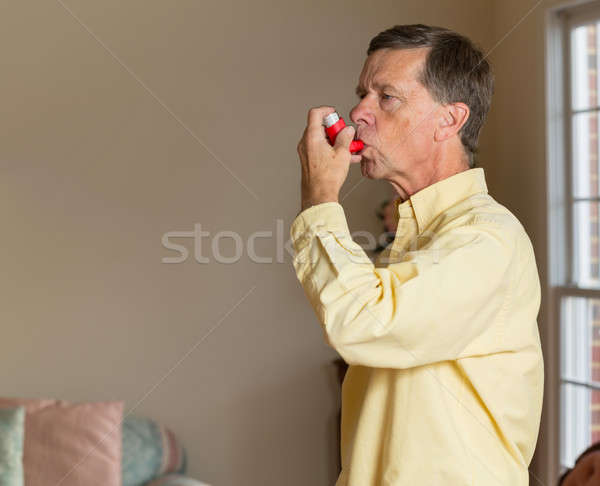 Senior retired man with asthma inhaler Stock photo © backyardproductions