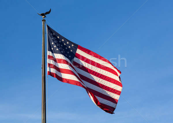 USA sterren vlag blauwe hemel wind Stockfoto © backyardproductions