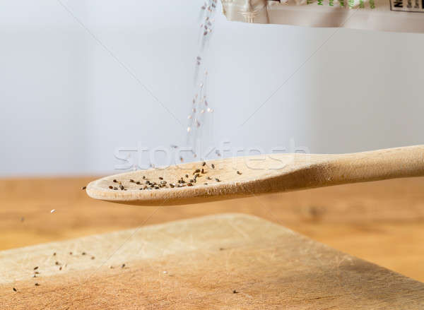 Tiny chia seeds in wooden spoon Stock photo © backyardproductions