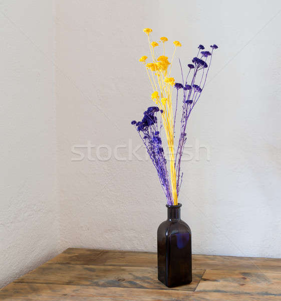 Dried flowers in blue bottle vase on wood Stock photo © backyardproductions
