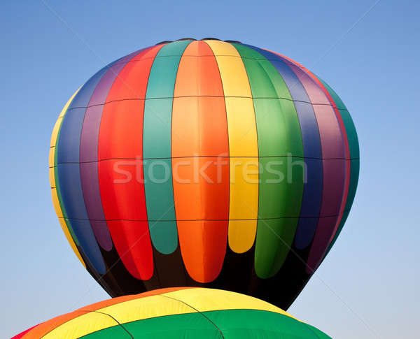 Multicolored Hot air balloon rising over another Stock photo © backyardproductions