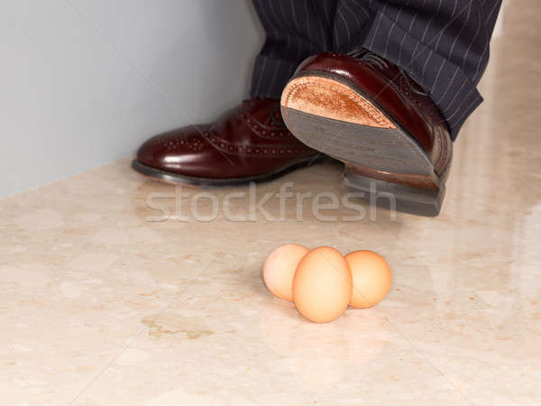Man's shoe stamping on three eggs Stock photo © backyardproductions