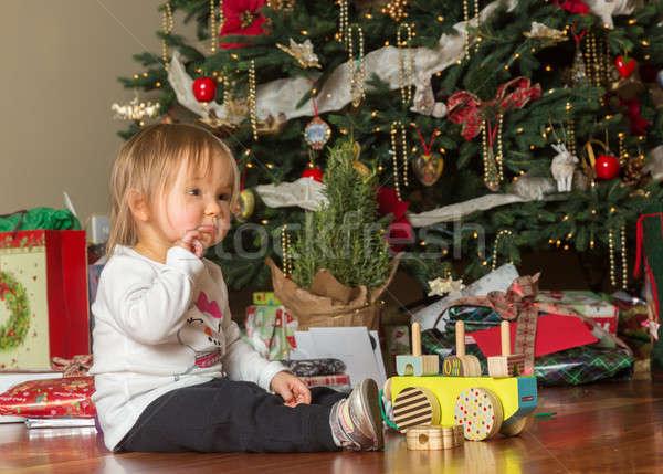 Young caucasian baby girl opening presents at xmas Stock photo © backyardproductions