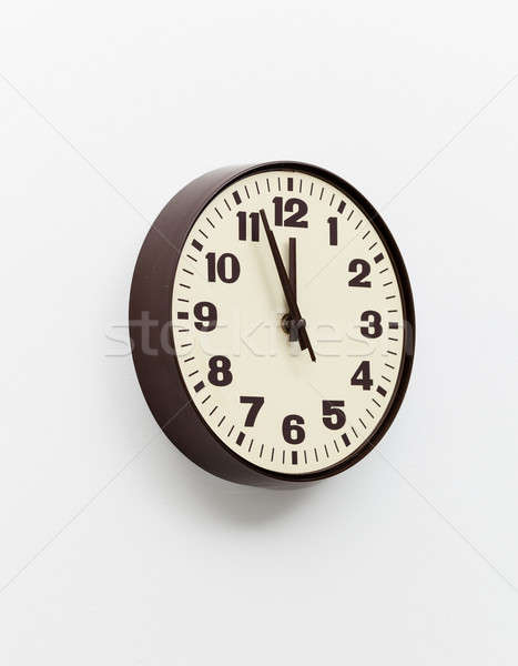 Brown clock on white office wall near noon Stock photo © backyardproductions