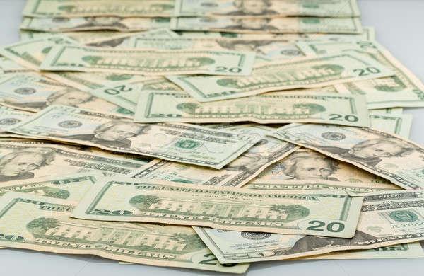 Many twenty dollar notes spread out on table Stock photo © backyardproductions