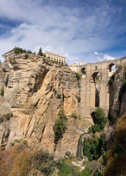 View down the steep rockface to valley in Ronda Stock photo © backyardproductions
