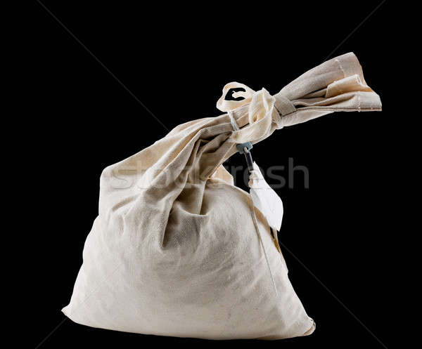 Cloth money bag tied up at neck and isolated Stock photo © backyardproductions