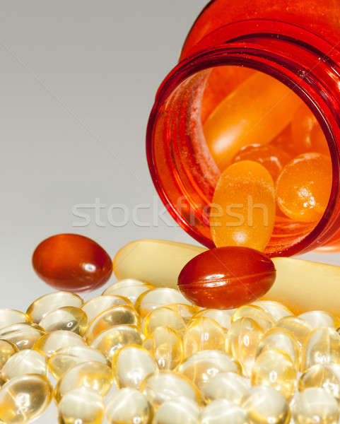 Macro of fish oil capsules in RX bottle Stock photo © backyardproductions