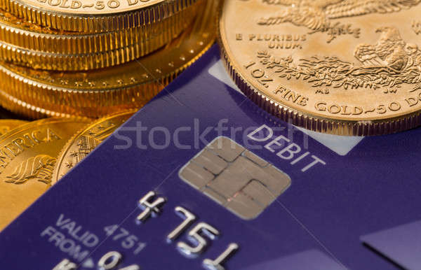 Gold coins on chip and pin debit card Stock photo © backyardproductions