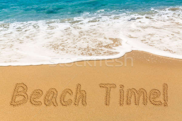 Beach Time written in sand with sea surf Stock photo © backyardproductions