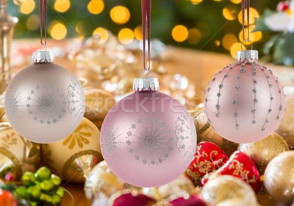 Three Christmas decorations on strings Stock photo © backyardproductions