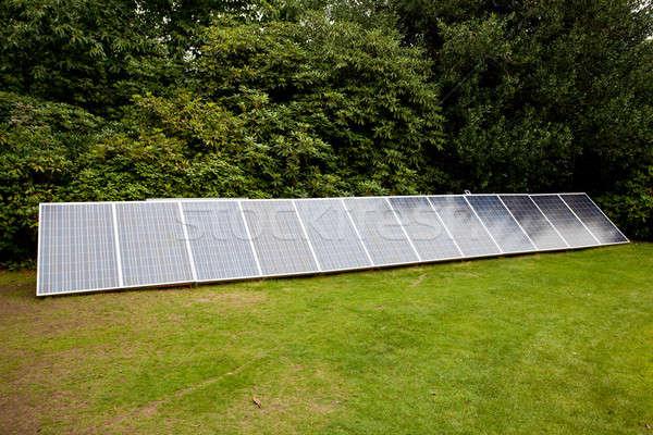 Solar panels in garden Stock photo © backyardproductions
