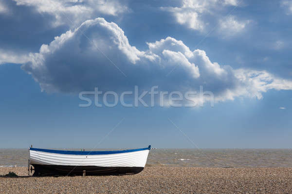 Old fishing boat on pebble beach  Stock photo © backyardproductions