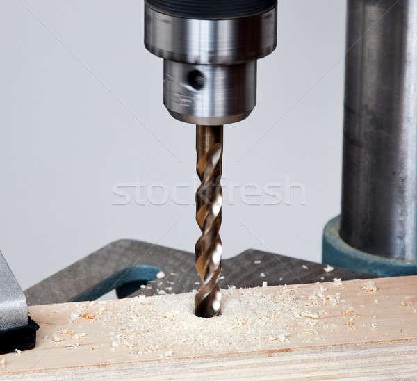 Close up of drill bit above wood Stock photo © backyardproductions
