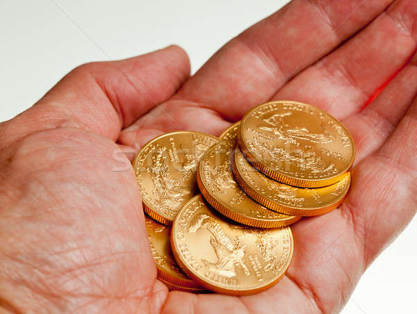 Hand holding stack of gold coins Stock photo © backyardproductions