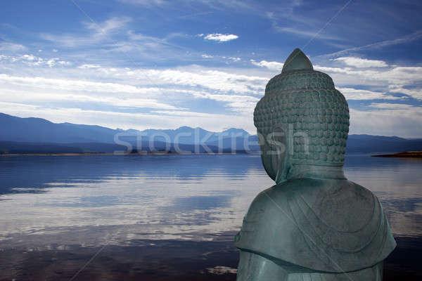Buddha overlooking lake Stock photo © backyardproductions