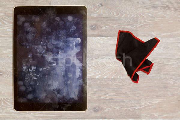 Cloth to wipe fingerprints and grease on tablet screen Stock photo © backyardproductions