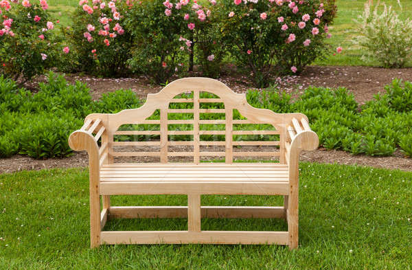 Teak chair or bench on green lawn Stock photo © backyardproductions