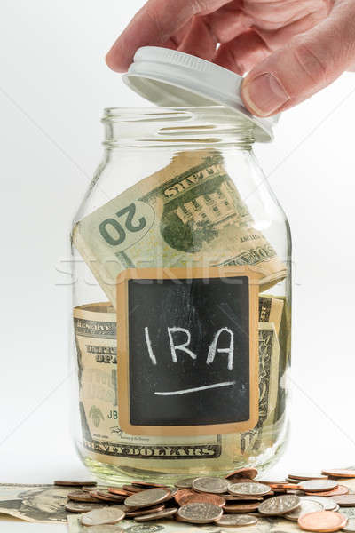 Hand opening glass Jar used for IRA fund Stock photo © backyardproductions
