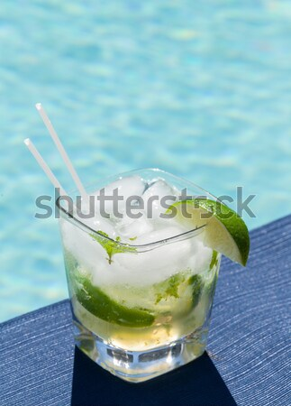 Cocktail Majito on edge by poolside Stock photo © backyardproductions