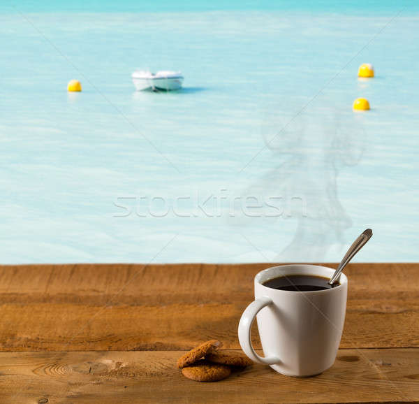 Morning cup of coffee by warm caribbean sea Stock photo © backyardproductions