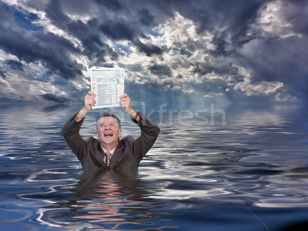 Senior man holding IRS form 1040 in water Stock photo © backyardproductions