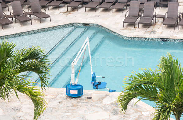 Disabled person pool lift by swimming Stock photo © backyardproductions