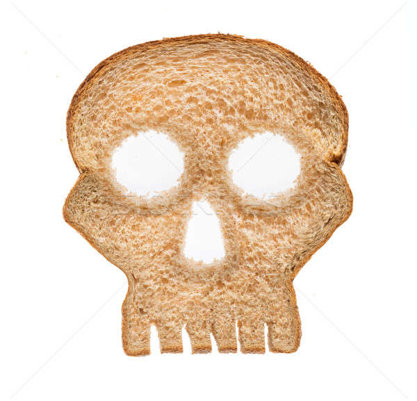Slice of wholewheat bread in shape of skull Stock photo © backyardproductions