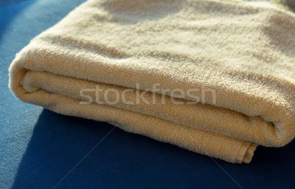 Sun shining on  yellow bath towels Stock photo © backyardproductions