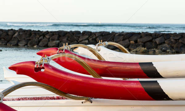 Sunrise over hawaiian canoes from Waikiki Hawaii Stock photo © backyardproductions