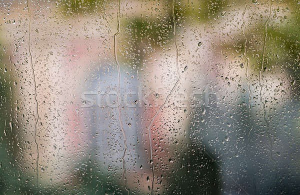 Raindrops on window with colorful background Stock photo © backyardproductions