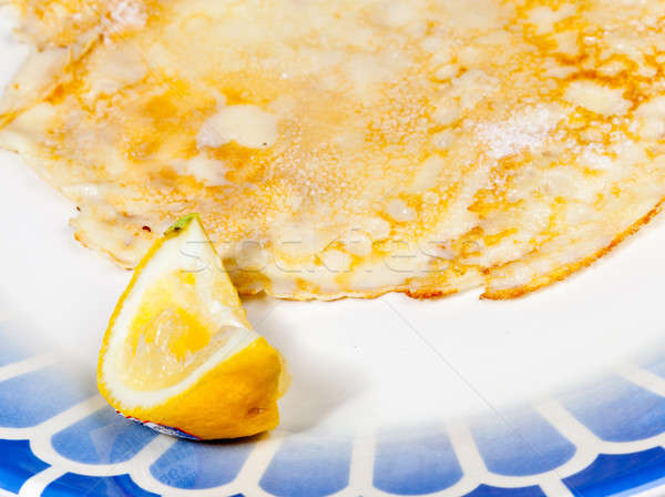 Pancake with lemon on blue plate Stock photo © backyardproductions