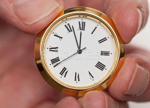 Latão pequeno ver relógio dedos ouro Foto stock © backyardproductions