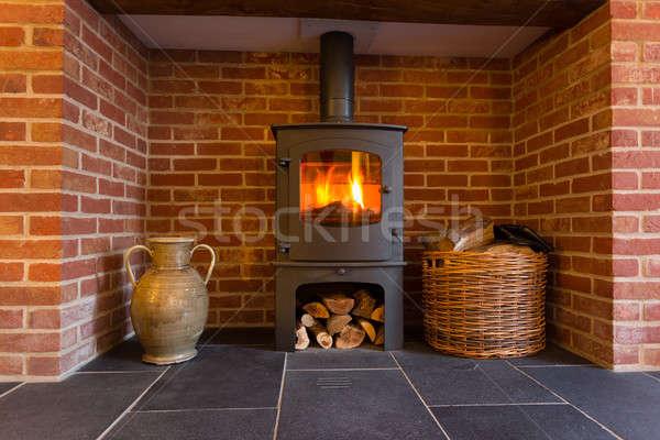 Ahşap yanan soba tuğla şömine yangın Stok fotoğraf © backyardproductions