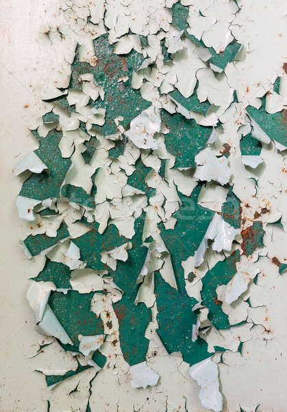 Old green paintwork on wall peeling off Stock photo © backyardproductions