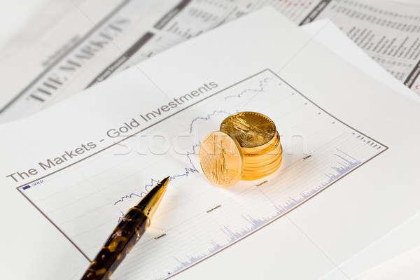 Gouden adelaar munten krant goud een Stockfoto © backyardproductions